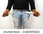 poor black man in jeans with... | Shutterstock . vector #1166505262
