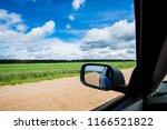 a road through the green... | Shutterstock . vector #1166521822