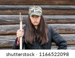 aggressive girl with an ax in... | Shutterstock . vector #1166522098