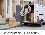 two young handsome movers... | Shutterstock . vector #1166538922
