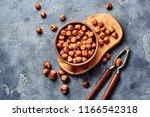hazelnuts with nutcracker on... | Shutterstock . vector #1166542318