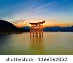 the torii gate of itsukushima... | Shutterstock . vector #1166562052