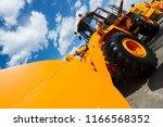 wheel loader  orange... | Shutterstock . vector #1166568352