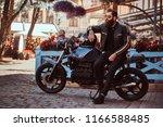 stylish fashionable biker in... | Shutterstock . vector #1166588485
