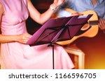 golden blues. man's male hands... | Shutterstock . vector #1166596705