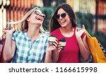 women in shopping. two happy... | Shutterstock . vector #1166615998