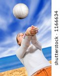 beautiful lady playing volleyball at the beach - stock photo