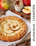Homemade open apple pie with spices. - stock photo