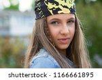happy hipster teenager. closeup ... | Shutterstock . vector #1166661895