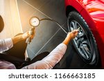asian man car inspection... | Shutterstock . vector #1166663185