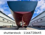 cargo ship stern moored in... | Shutterstock . vector #1166728645