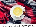 cup of tea with lemon on red... | Shutterstock . vector #1166753995