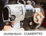 Small photo of Tools used to tighten the nut or tighten.In the manner of tightening torque by using wind power to drive , soft focus , blurred.