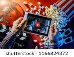 hands holding a blank digital... | Shutterstock . vector #1166824372