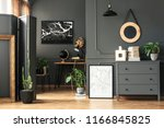 black map on grey wall in dark... | Shutterstock . vector #1166845825
