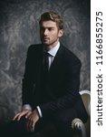 portrait of a handsome man in... | Shutterstock . vector #1166855275