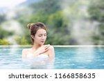 young  woman relaxing in hot...   Shutterstock . vector #1166858635