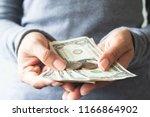 close up us dollar bills and... | Shutterstock . vector #1166864902