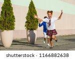 laughing schoolchildren   a... | Shutterstock . vector #1166882638