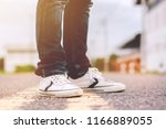men jeans and sneaker shoes on... | Shutterstock . vector #1166889055