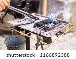 the blacksmith forge.... | Shutterstock . vector #1166892388