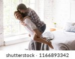excited young couple having fun ... | Shutterstock . vector #1166893342