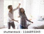 happy funny millennial couple... | Shutterstock . vector #1166893345