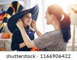 happy family preparing for... | Shutterstock . vector #1166906422