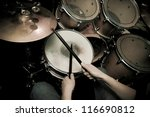 The Drummer In Action. A Photo...