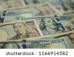 background with us currency and ... | Shutterstock . vector #1166914582