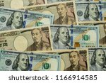 background with us currency and ... | Shutterstock . vector #1166914585