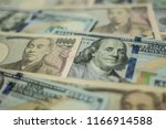 background with us currency and ... | Shutterstock . vector #1166914588