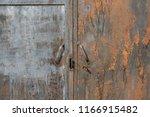 old rusty gate. metal doors | Shutterstock . vector #1166915482