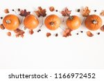 autumn composition. pumpkins ... | Shutterstock . vector #1166972452
