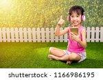 asian little chinese girl... | Shutterstock . vector #1166986195