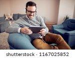 man relaxing at home listening... | Shutterstock . vector #1167025852