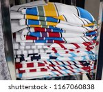folding  clothes  on  the ...   Shutterstock . vector #1167060838
