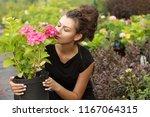 beautiful curly woman choosing...   Shutterstock . vector #1167064315