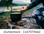 camp and cooking in field... | Shutterstock . vector #1167074662