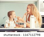 child with mother drinking milk.... | Shutterstock . vector #1167112798