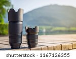 Lenses of photo camera standing in a row. Zoom tele lens and wide angle lens with fixed focal length from dslr camera