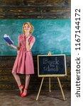 pretty woman read academic... | Shutterstock . vector #1167144172
