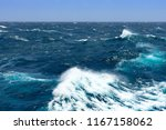 big waves at open sea. summer... | Shutterstock . vector #1167158062