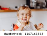 toddler girl laughing and... | Shutterstock . vector #1167168565