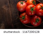 Fresh Tomatoes In A Plate On A...