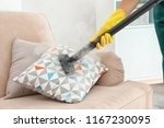 janitor removing dirt from sofa ... | Shutterstock . vector #1167230095