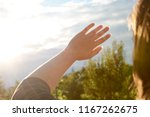 a young woman protects her eyes ... | Shutterstock . vector #1167262675