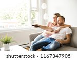 couple watching tv at home... | Shutterstock . vector #1167347905