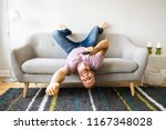 man listening tv upside down on ... | Shutterstock . vector #1167348028