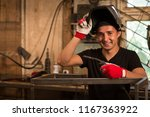 Male Worker Leaning On Metal...